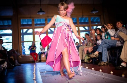 Family members applaud a camper as he makes his way down the fashion-show runway.  Lindsay Morris