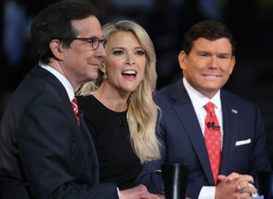 CLEVELAND, OH - AUGUST 06:  FOX News anchors (L-R) Chris Wallace, Megan Kelly and Bret Baier moderate the first prime-time Republican presidential debate hosted at the Quicken Loans Arena August 6, 2015 in Cleveland, Ohio. The top-ten GOP candidates were selected to participate in the debate based on their rank in an average of the five most recent national political polls.  (Photo by Chip Somodevilla/Getty Images)